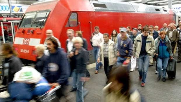 Passengers disembark at the Hauptbahnhof train station in Munich. Deutsche Bahn, Germany's state rail operator, plans to use drones to catch culprits leaving graffiti on its trains at night.