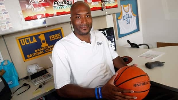 Former UCLA basketball player Ed O'Bannon Jr. , shown in his workplace office in Henderson, Nev. in 2010, is part of a lawsuit seeking revenue sharing for NCAA athletes.