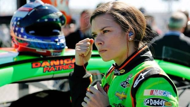 Danica Patrick removes her earplugs after qualifying for the NASCAR Daytona 500 Sprint Cup Series stock car race. Her time would stand up for the rest of the afternoon as the fastest time for the Great American Race.