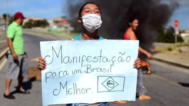A group of demonstrators attempt to block the road from the airport to the city in Belo Horizonte, Brazil on Wednesday ahead of the Brazil vs. Uruguay game at the Confederations Cup.