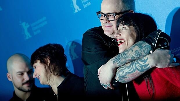 Director Denis Côté hugs actress Romane Bohringer following Sunday's screening in Berlin, as co-stars Pierrette Robitaille and Marc-André Grondin look on.