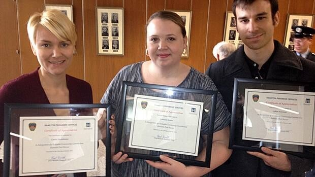 Carrie Stonehouse, Lorraine Green and Adam Freeman saved a patron who had a heart attack in the pool. They were honoured Monday with other life savers, including paramedic Mike North, who pulled a woman from a burning vehicle. (Samantha Craggs/CBC)