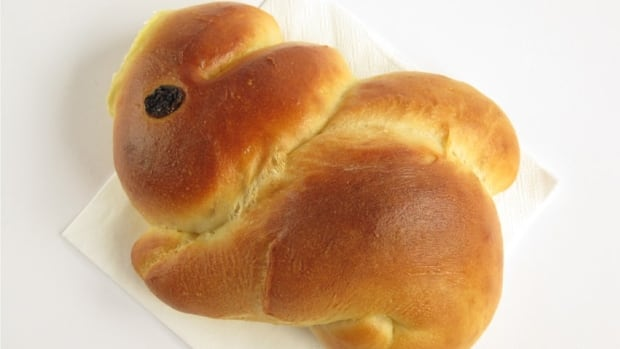 An Easter bunny made of bread with a raisin eye.