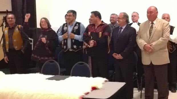 The group of aboriginal leaders and federal and territorial leaders shortly before signing the deal in Inuvik, N.W.T., on Tuesday evening.