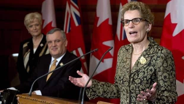 Lt.-Gov. David Onley listens as Ontario premier-designate Kathleen Wynne speaks at the Ontario legislature in Toronto on Thursday.
