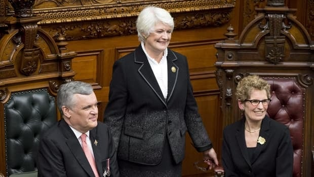 Ontario Lt.-Gov. David Onley and Premier Kathleen Wynne pose with new Education Minister Liz Sandals at a swearing-in ceremony at Queen's Park on Monday. Sandals is new to cabinet and faces the difficult task of restoring the province's strained relationship with teachers.