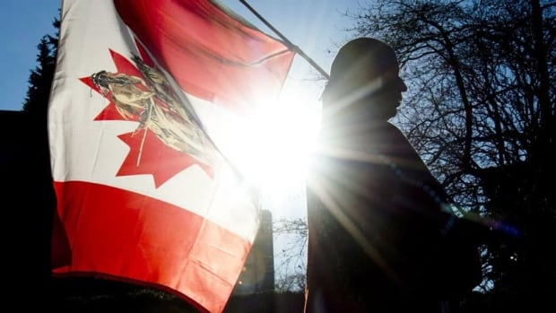 Earl Sunshine of Grand Prairie takes part in an Idle No More protest outside Vancouver City Hall in Vancouver, B.C., on Friday.