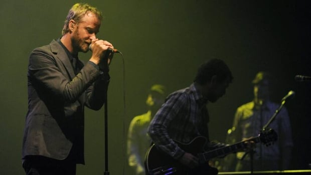 Matt Berninger, left, and fellow members of The National perform in 2010. Their latest album is Trouble Will Find Me.