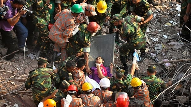 Rescuers carry the survivor out the wreckage of a building in Bangladesh after 17 days in the rubble. More than 1,000 people died in the factory collapse on Apr. 24.