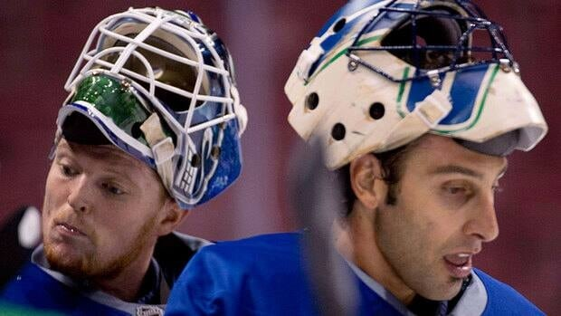 Canucks' Roberto Luongo, right, was thought to be heading out of Vancouver by the time the lockout-shortened season began. Now, he's outplaying his younger goaltending partner, Cory Schneider, left.