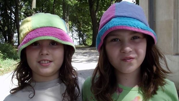 Delanie, left, and Mackenzie are twin autistic sisters whose father, Paul Ceretti, started a non-profit progam when their government-funded therapy was cut off.