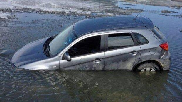A car at the Government Street dock landing, on Wabigoon Lake near Dryden, cracked through the ice on Sunday. Police are now warning people to stay off the lake due to the unstable conditions.