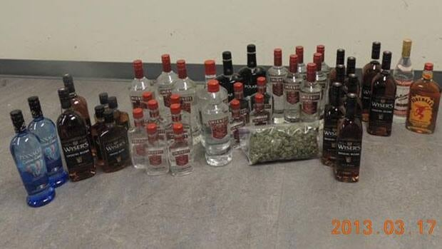 RCMP in Fort Liard, N.W.T., seized 42 bottles of liquor and 100 grams of marijuana in a recent checkstop.