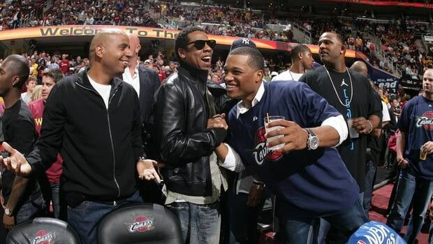 Jay-Z and Robinson Cano of the New York Yankees shake hands at an NBA game on May 28, 2009 in Cleveland, Ohio.