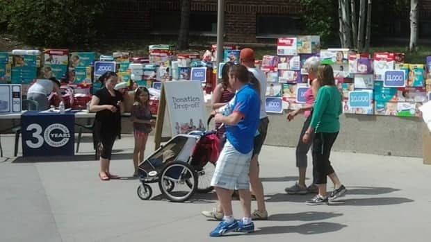 The Bare Bottoms Diaper Drive has collected more than 20,000 diapers for local families at their donation drive.