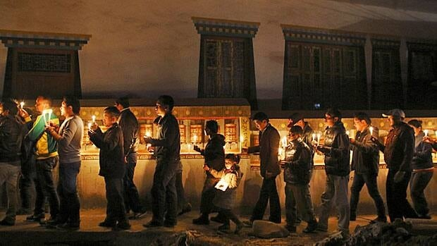 Tibetans in Nepal hold a candlelight vigil on Wednesday to show solidarity with those who have immolated themselves and to mark the 100th anniversary of the 1913 Tibetan proclamation of independence.