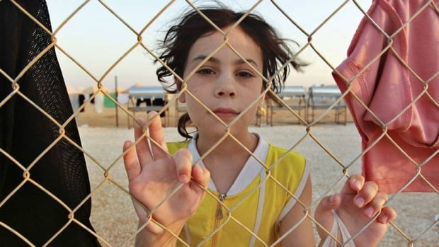 A Syrian refugee is shown at a camp in Jordan last year. By the end of 2012, the world had 15.4 million refugees, 937,000 asylum seekers and 28.8 million people who had been forced to flee within the borders of their own countries.