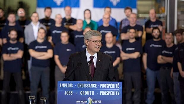 Prime Minister Stephen Harper announced a repayable loan of over $9.2 million to Premier Tech Ltd. in Rivière-du-Loup, Que. Thursday. Outside, union members were picketing his government's recent changes to the employment insurance program.