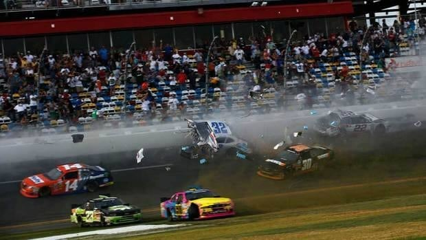 Kyle Larson, driver of the #32 Clorox Chevrolet, and Brad Keselowski, driver of the #22 Discount Tire Dodge, are involved in an incident at the finish at Daytona International Speedway on Saturday in Daytona Beach, Fla.
