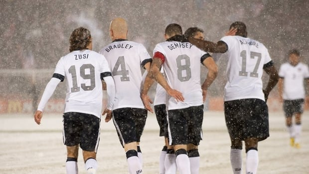 American midfielder Clint Dempsey (8) is congratulated by teammates after scoring against Costa Rica on March 22, 2013 in Commerce City, Colorado.