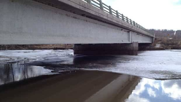 Water levels in the Assiniboine River rise along Provincial Road 259 near Virden, Man., on Wednesday.