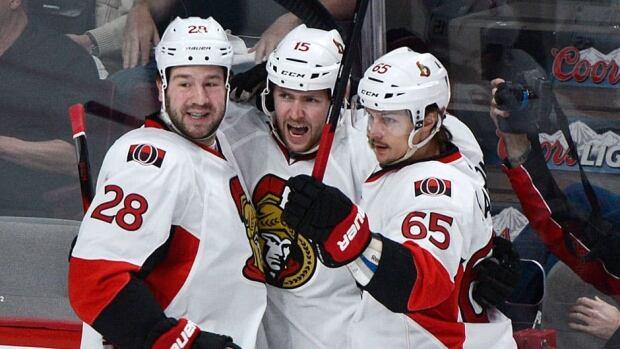 Ottawa Senators' Zack Smith, centre, celebrates with teammates Matt Kassian, left, and Erik Karlsson, right, after scoring the first goal of the game Thursday against the Ottawa Senators.