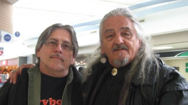 Brothers, Brian Reynoldson (left) and Jim Poitras, meet for first time at the Saskatoon International Airport.