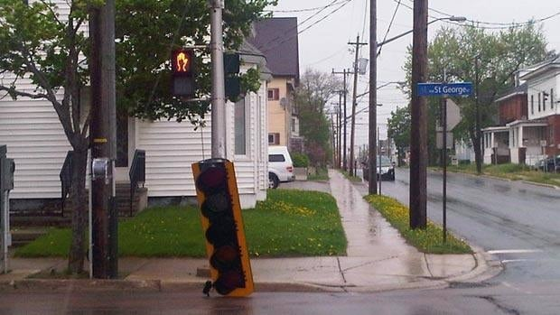 A traffic light in Moncton was damaged due to heavy wind.