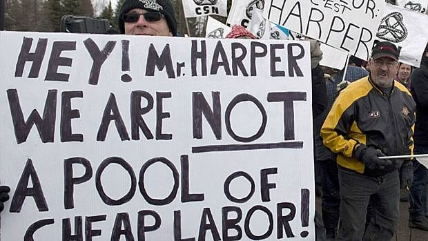 Union members in Riviere-du-Loup protest against more stringent employment insurance rules outside a company that Prime Minister Stephen Harper was visiting on Thursday. In Parliament, the criticism was even more pointed.