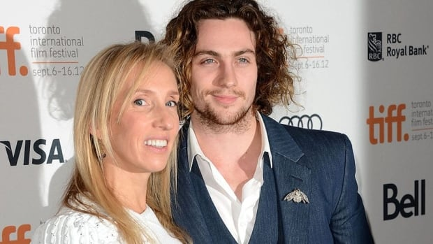 Director Sam Taylor-Johnson, seen with her actor husband Aaron Taylor-Johnson at the 2012 Toronto International Film Festival, has been enlisted to helm the Fifty Shades of Grey movie adaptation.