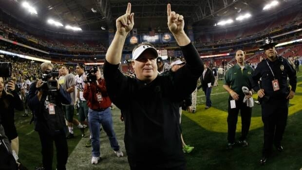 Oregon Ducks head coach celebrates after his team defeated the Kansas State Wildcats in the Tostitos Fiesta Bowl on Thursday.