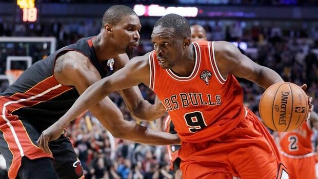 Chicago Bulls' Luol Deng, right, drives against Miami Heat's Chris Bosh on Wednesday, March 27, 2013.