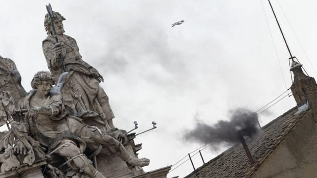 Black smoke, including sulphur and a coal tar component, rises from the chimney on the roof of the Sistine Chapel in the Vatican City on Wednesday.