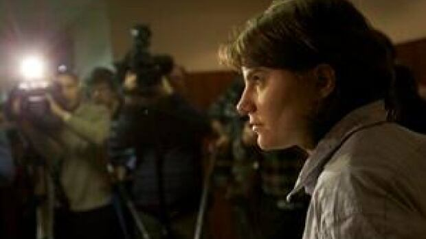 Pussy Riot punk band member Yekaterina Samutsevich speaks to press after a court hearing in Moscow on Wednesday. Her efforts to repeal a decision banning the group's videos in Russia was rejected by the court.