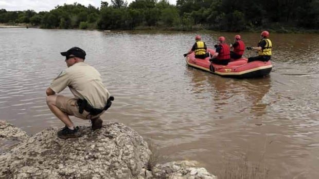 Members of a the Shertz Fire Department and Texas Parks and Wildlife search for a missing teen who was swept away in a rain swollen Cibilo Creek.