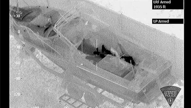 This infrared photo taken from a police helicopter on April 19 shows Boston bombing suspect Dzhokhar Tsarnaev, the dark figure on the far side, hiding in a boat in Watertown, Mass.