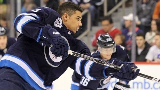 Young forward Evander Kane, left, has raised eyebrows with both his skilled play and his questionable behaviour away from the rink.