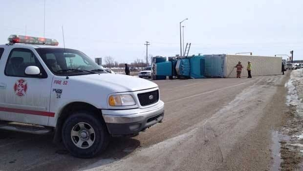 A semi-trailer is seen flipped onto its side on Highway 16 at the junction with the Trans-Canada Highway west of Portage la Prairie, Man., on Tuesday afternoon.