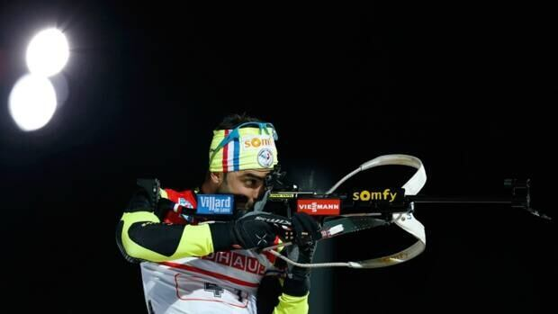 France's Simon Fourcade shoots during the men's 4x7,5 kilometre relay race at the Biathlon World Cup competition in Ruhpolding, Germany, on Thursday.