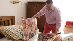 Alain Laliberte sorts through a sample of his collection of wine labels at his Etobicoke home. Laliberte has a collection of 160,000 labels from around the world.