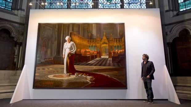 Artist Ralph Heimans poses beside his official portrait of Queen Elizabeth II, entitled The Coronation Theatre: Portrait Of Her Majesty Queen Elizabeth II, inside the Chapter House at Westminster Abbey in May.