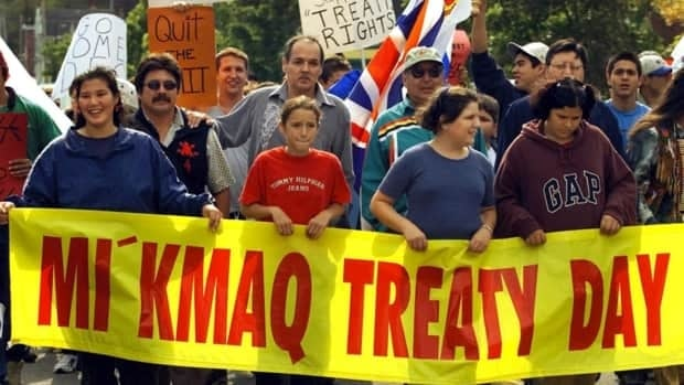Donald Marshall Jr., centre in grey, walks through Sydney, N.S., in a peaceful protest over native fishing rights on Sept.28, 2000. Marshall's court battle over fishing rights led to a 1999 Supreme Court decision that recognized the Mi'kmaq and Maliseet people's treaty rights to earn a 'moderate livelihood' from commercial fishing and hunting.