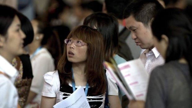 Young Chinese job seekers attend a jobs fair. The Chinese economy slowed its rapid pace of growth to 7.5 per cent in the second quarter.