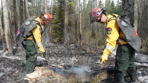 Firefighters work on the Lodgepole fire.