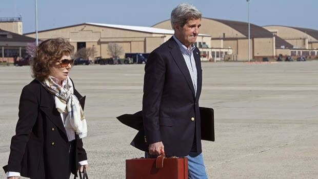 U.S. Secretary of State John Kerry and his wife Teresa Heinz Kerry board a second plane after their original aircraft had mechanical problems on Saturday at Andrews Air Force Base in Maryland. Kerry is on his third trip to the Middle East in two weeks.