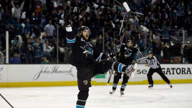 From left to right, Patrick Marleau (12), Logan Couture (39), Joe Pavelski (8) and Joe Thornton (19) of the San Jose Sharks celebrate Pavelski's first-period goal as Canucks goalie Cory Schneider looks on at HP Pavilion on Sunday in San Jose, Calif.