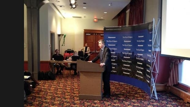 Acting city assessor Harvey Fairfield speaks at a news conference in Calgary on 2013 property assessments.