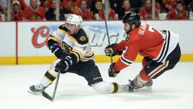 Defenceman Brent Seabrook (7) and the Chicago Blackhawks got the better of Brad Marchard, left, and the Boston Bruins in Game 5.