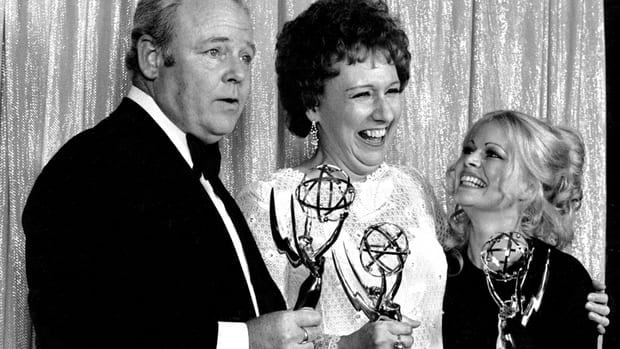 All in the Family cast members Carroll O'Connor, Jean Stapleton, and Sally Struthers pose with their Emmys backstage at the 24th annual Emmy Awards in Hollywood, Calif., in 1972.