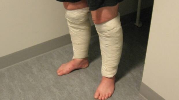 A man was arrested at Pearson International Airport earlier this month after being caught with two food-saver packs of suspected cocaine taped to his legs.